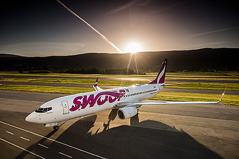 Swoop airplane at sunrise.